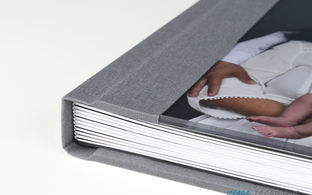 Our custom designed album is a perfect way to display and preserve photos from your newborn session